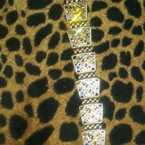 Bracelet w/ multi colored crystals.